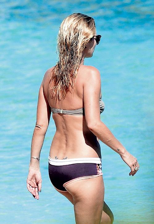 Безупречное тело Кейт стойко вынесло даже две татуировки