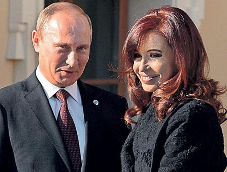 ПУТИН с президентом Аргентины Кристиной Фернандес де КИРШНЕР. Уго ЧАВЕС незадолго до смерти утверждал, что американцы и у неё вызвали рак щитовидной железы