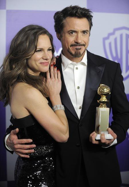 Роберт Дауни с женой Сьюзан Левин. Фото: АР