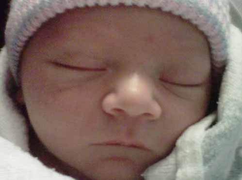 Первое фото внука Джима Керри Джексона Райли Сантаны.